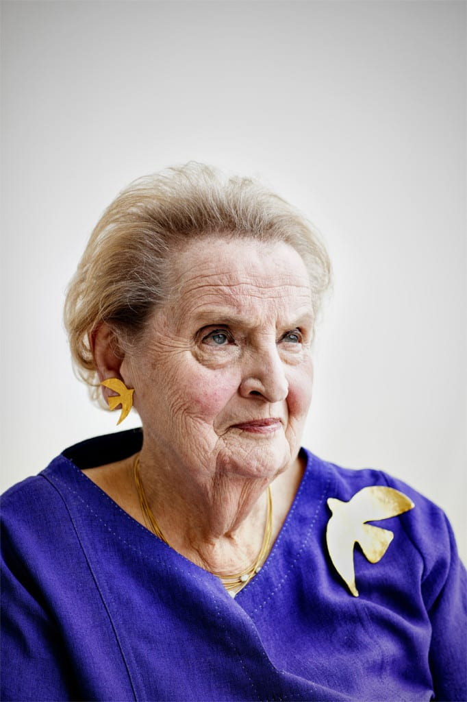 Madeleine Albright is photographed at the Albright Stonebridge Group offices in Washington, D.C. wearing a replica of the Cécile & Jeanne dove pin given to her by Leah Rabin. Albright's propensity for wearing pins that communicated subtle messages was well known during her tenure as Secretary of State.